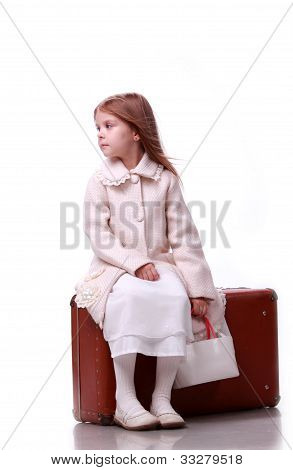 Cute kid on a suitcase