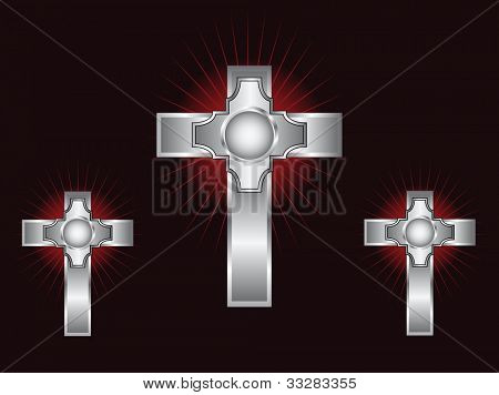 Three ornate silver crosses on a maroon background with highlighted rays