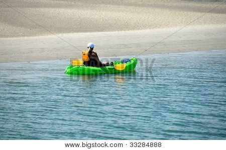 Lady Kayaker On The River