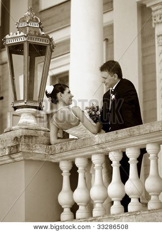 Newlywed couple on balcony