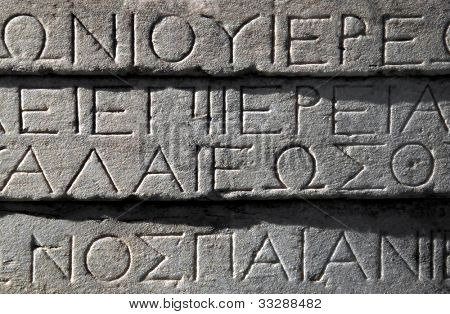 Ancient Greek writing engraved on Parthenon building, Athens, Greece.