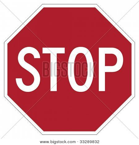 Hexagonal red stop sign isolated on white background.