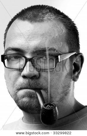 Man face with beard and glasses and smoking pipe
