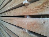Lumber Warehouse In The Open Air. Wooden Beams, Planks Of Wood, Stacked In Stacks. Horizontal Photo poster
