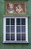 Window With Decorations On The Wall Of Renovated Old Tenement House In Gdansk Old Town, Poland poster