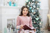 New Year Eve. Little Girl Reading Christmas Story. Magic Atmosphere. Christmas Spirit. Little Reader poster