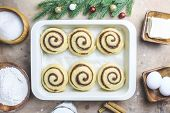 Cinnamon Rolls, Homemade Recipe Raw Dough Preparation And Ingridients. Traditional Sweet Buns. Danis poster