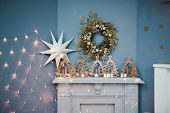 Fireplace With Christmas Decor. Beautiful New Years Interior With A White Fireplace. Christmas Inter poster