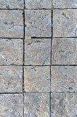 Granite Cobblestoned Pavement Background. Fragment Of A Pavement Along A Street In Greece. poster