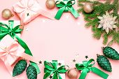 Pink Christmas Card Or New Year Background, Flat Lay, Copy Space. Pastel Pink Gift Boxes And Green,  poster