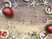 Christmas Decoration On Wooden Background. Copy Space. Christmas Concept. Red Balls, Straw Decor, Go poster
