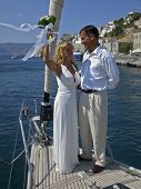 pic of hydra  - Newly wed couple getting married on a sailboat in the port of Hydra in Greece.