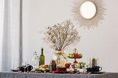 Trendy Mirror In Golden Frame On White Wall Of Elegant Dining Room poster