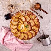 French Sweet Pie Tart Tatin Apple Cake Upside Down  Over On Gray Concrete Background. Top View poster