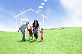 picture of villa  - Happy family running on field with a drawn house in background - JPG