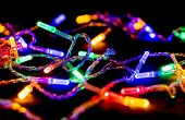 Multicolored Garland With Glowing Lights On Black Background. Christmas, New Year, Birthday And Wedd poster