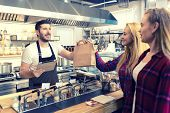 Waiter Serving Takeaway Food To Customers At Counter In Small Family Eatery Restaurant - Trendy Fast poster