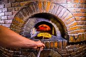 Traditional Italian Pizzeria Background With Stone Stove Oven, Pizza And Pizza Maker Hands. Stone St poster