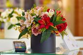 Flower Arrangement In The Interior Of The Store. Beautiful Decoration Of The Store With Flowers. Flo poster