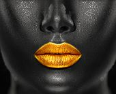 Lips Makeup art, black skin and Gold lips, golden lipgloss on sexy lips, golden lipstick. Beautiful  poster