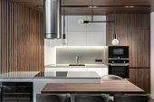 Modern Kitchen In New And Contemporary Apartment With Wooden Style Element And Built In Appliance poster