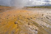 Colorful Limestone Deposits By A Geothermal Pool In The Geysir Geothermal Area In Iceland poster