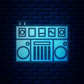 Glowing Neon Dj Remote For Playing And Mixing Music Icon Isolated On Brick Wall Background. Dj Mixer poster