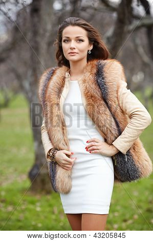 Portrait Of Beautiful Young Woman In Fur