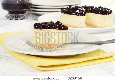 blueberry cheesecake on yellow napkin