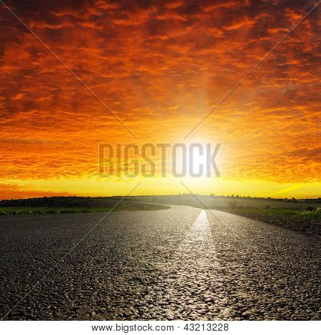red dramatic sunset over asphalt road