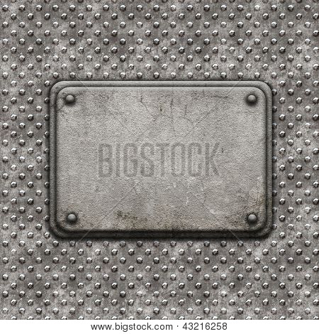 Grunge style background with metal rivets and stone plaque