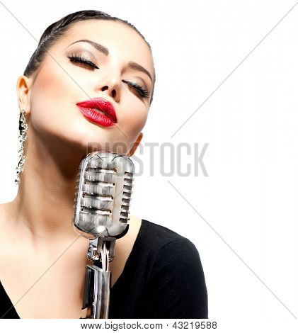 Singing Woman with Retro Microphone. Beauty Glamour Singer Girl Portrait. Isolated on White Background. Vintage Style. Song