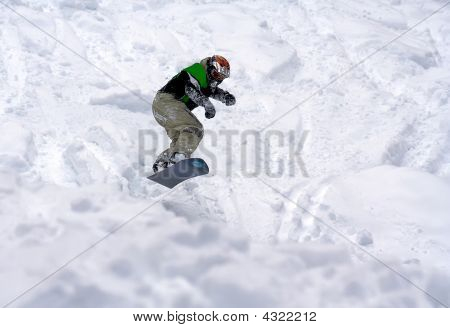 Snowboarder Ride In Powder