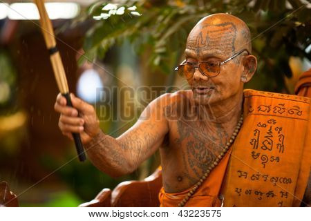 KO CHANG, THAILAND - NOV 28: Buddhist lama blesses participants Loy Krathong festival, Nov 28, 2012 on Chang, Thailand. Loi Krathong takes place annually on the evening of the full moon of 12th month.