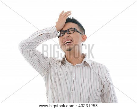 Asian Chinese Male Having Headache With Isolated White Background