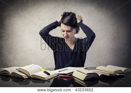 confused student with hands in the hair