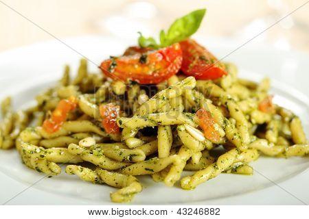 Italian pasta with pesto and tomatoes