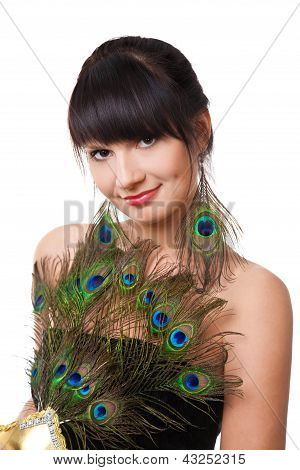 Attractive brunette woman with peacock earrings and fan