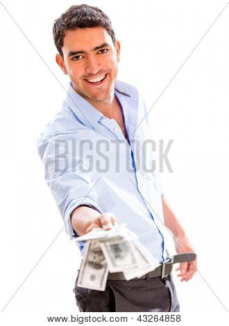 Successful business man holding money - isolated over a white background