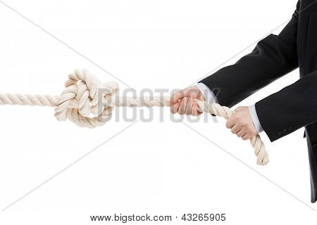 Competition concept - business man in black suit hand holding or pulling rope with tied knot white isolated