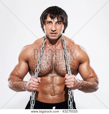 Agressive bodybuilder with chain over white background