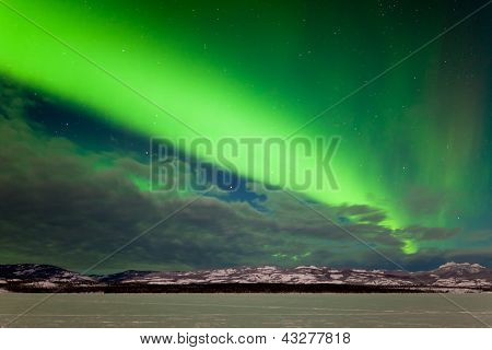Intense band of Northern Lights in northern winter
