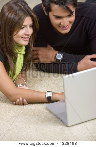 Couple On A Laptop At Home