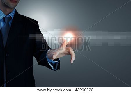 Business man touching display