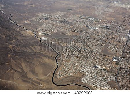 Aerial of the California aqueduct winding past Palmdale California.