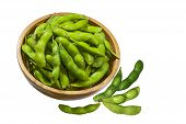 stock photo of nibbling  - Soybean Soy beans edamame nibbles in wooden bowl - JPG