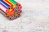 picture of end rainbow  - The ends of color pencils on wooden background - JPG