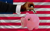 Dollar Into Piggy Rich Bank And  National Flag Of Liberia