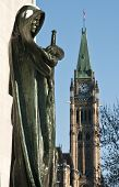 picture of adonis  - The statue Justicia from the supreme Court overlooking the Peace Tower of the canadian Parliament in Ottawa Canada - JPG
