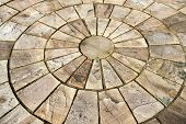 foto of grout  - Details of circle design stone floor tiles for outdoors garden - JPG